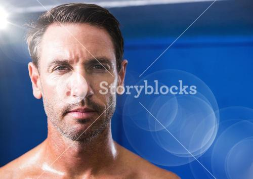 Close up of mans face with flare against blue background