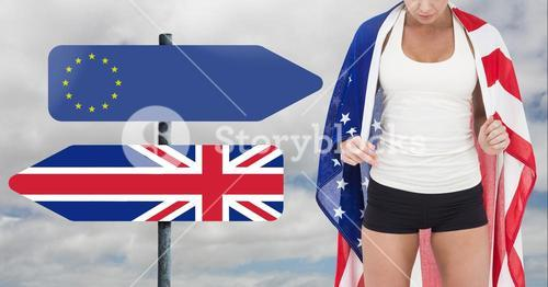 Fitness woman Torso holding american flag with arrow representing the European union in one side and