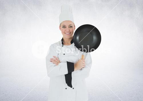Chef with frying pan against white background