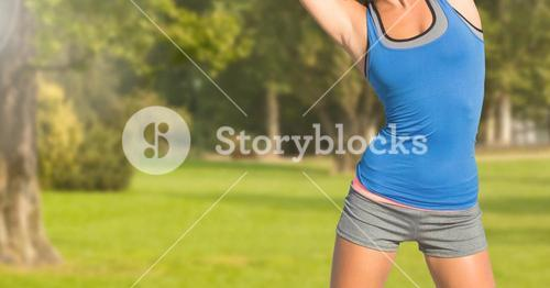 Fitness woman Torso making exercises in a park