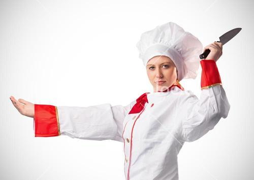 Chef with knife against white background