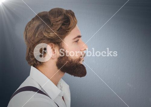 Composite image of Man with beard against navy background with flare