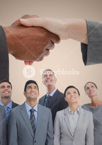 Composite image of Handshake over business people and cream background