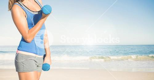 Composite image of woman Fitness Torso against sea