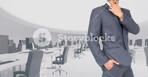 Composite image of Businessman Torso against large office