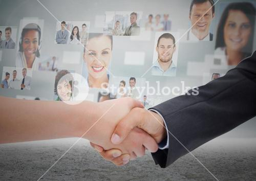 Composite image of Handshake in front of sky with business people