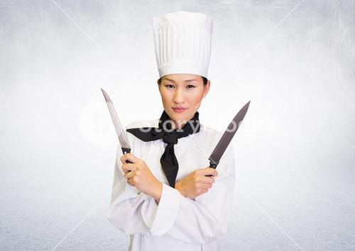 Composite image of Chef with knives against white background