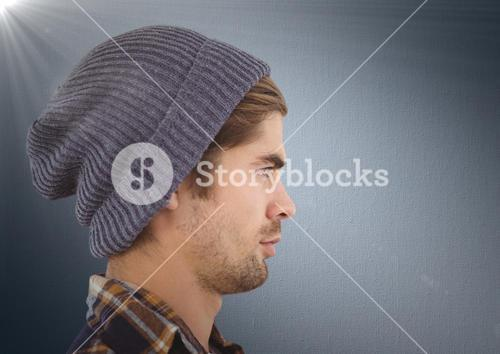 Composite image of Man with beanie against navy background with flare
