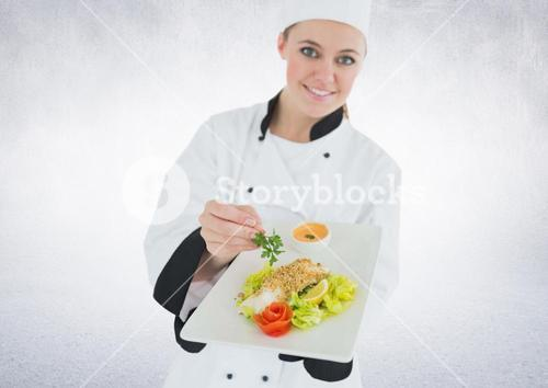 Composite image of Chef with plate of food against white background