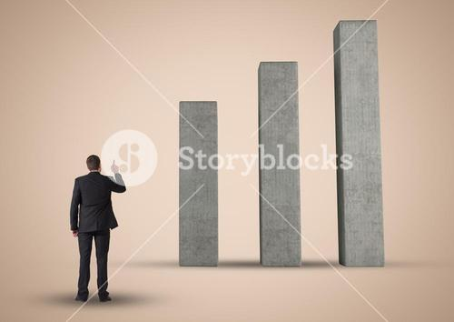 Composite image of Business man Standing looking at Graph against neutral background