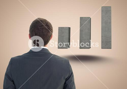Composite image of Business man Standing looking at Graph against a neutral background