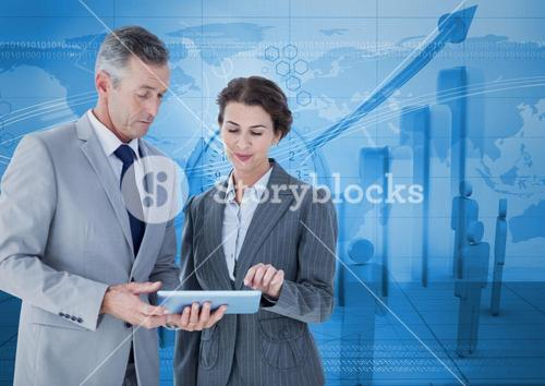 Composite image of Business people standing while looking at tablet against blue graph background