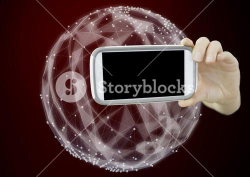 Composite image of Hand holding cell Phone against Sphere Polygons