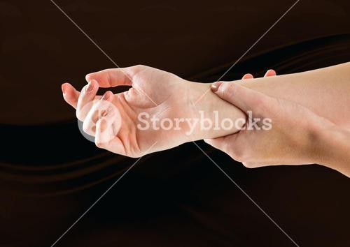Composite image of woman hands restraining against dark background