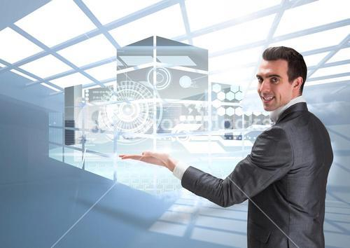 Composite image of business man presenting digital buildings projects