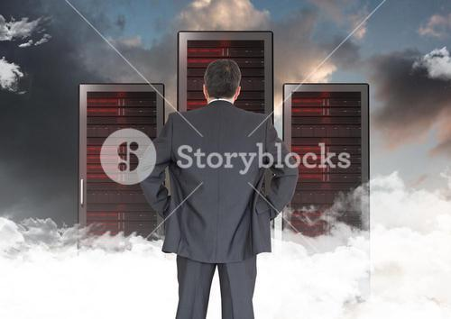 Composite image of Businessman Standing looking at folders against dark sky