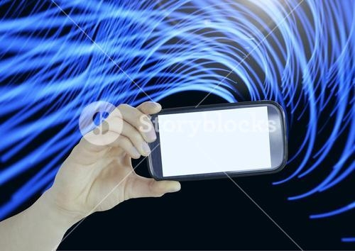 Composite image of Hand holding cell Phone against light effects