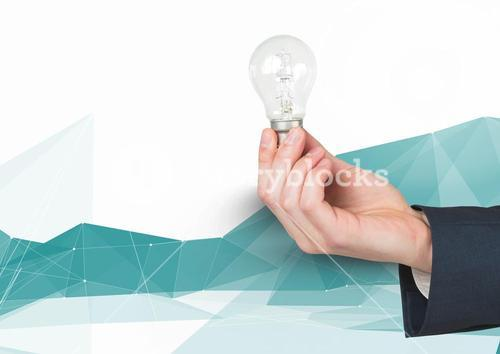 Composite image of Hand Holding Lightbulb against graphic Polygons