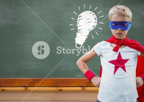 Composite image of superhero kid against blackboard with lightbulb