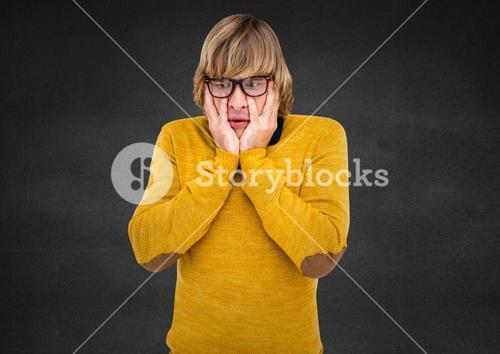 Composite image of stunned Man in yellow against grey background