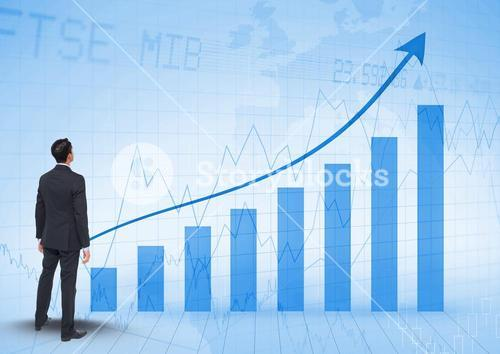 Composite image of Businessman Standing and looking at Graph