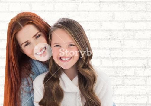 Mother and Daughter Smilling against a neutral background