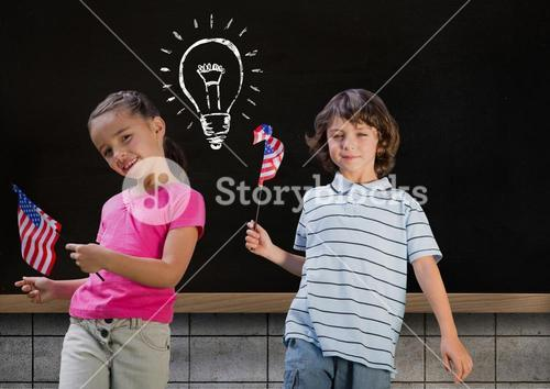 kids and blackboard with lightbulb against black background
