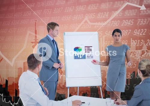 Business Team Standing and Speaking in front of Graph against an orange background