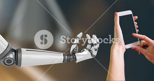 Composite Image of Robotic and Human Hand with phone Interact against dark background