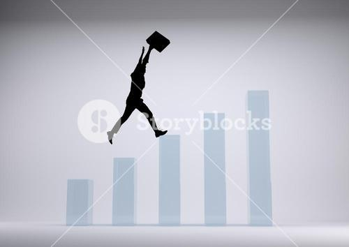 Businessman black Silhouette raising arms on graph against a grey background