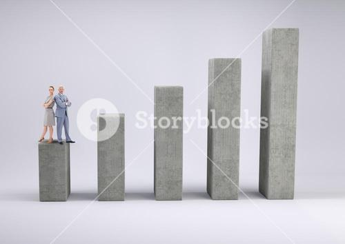 Business man and woman standing on graph against a grey background