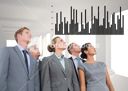 Business Group Standing looking at Graph against a grey background