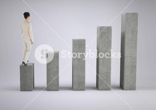 Businesswoman standing on graph against grey background