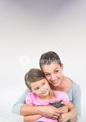 Mother and Daughter Hugging against a neutral background