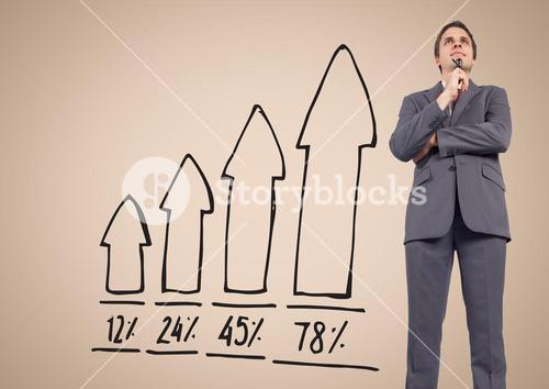 Businessman Standing in front of Graph against a nude background