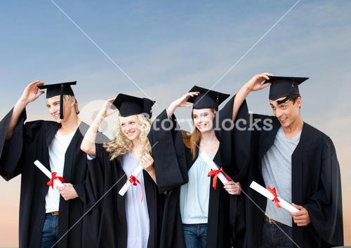 Students Graduation holding their hats against a blue background