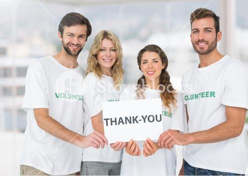 Happy Volunteer group showing Thank you sign against a light background