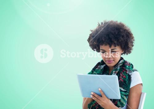 Woman using tablet against a light green background