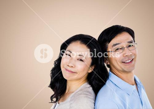 Happy Couple smiling against a neutral background