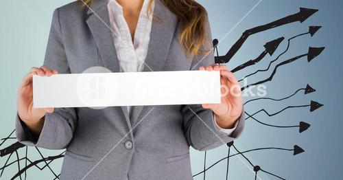 Businesswoman Standing in front of Graph against blue background
