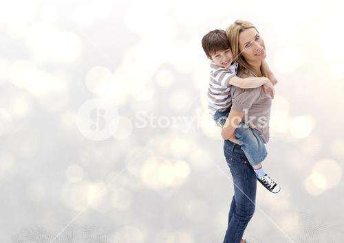 Mother and her son against a neutral background