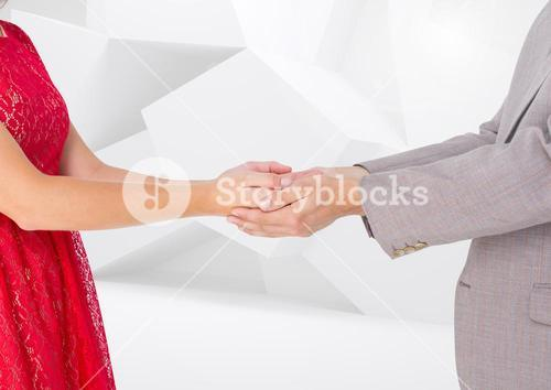 Composite Image of a Couple holding their hands against a white background