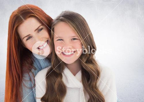 Mother and daugther against a neutral background