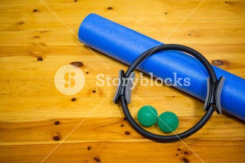Exercise equipment kept on wooden floor