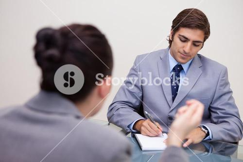 Businessman in negotiation taking notes
