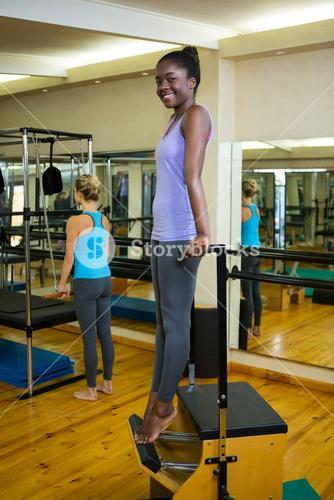 Happy woman exercising on wunda chair