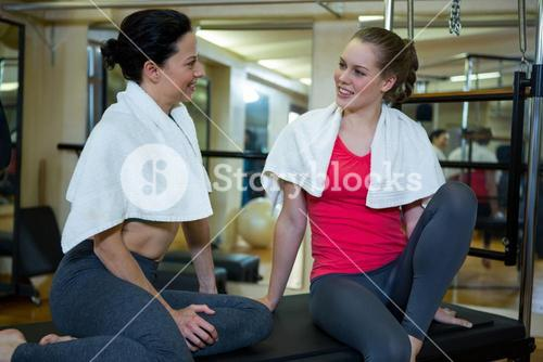 Happy women interacting with each other after workout