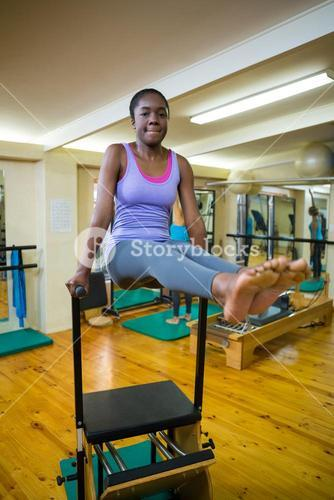 Portrait of woman exercising on wunda chair