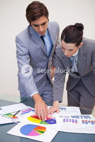 Consultant and customer looking at statistics