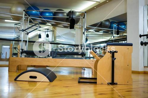 Various gym equipments on wooden floor